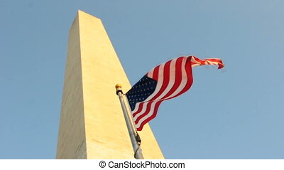 America Flag at Washington Monument - A flag flies before...
