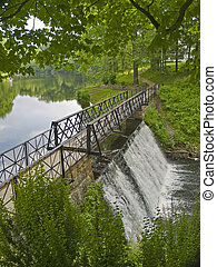 Footbridge Park - A Summer view of the waterfall and bridge...