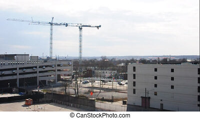 Construction Cranes - two tall cranes construct up a...
