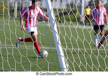 Soccer football - Footballl soccer attacking the net,...