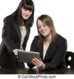 Young women playing on Ipad with expressive faces