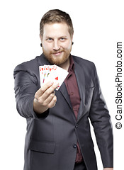 Young bearded man playing with cards smiling