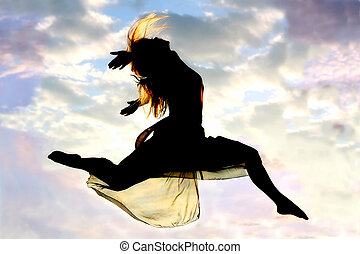 Woman Leaps through Air Silhouette - A young, attractive...