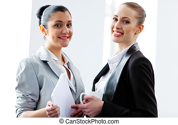 Two attractive business women smiling - Image of two young...