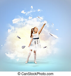 Little girl playing with paper airplane - Image of little...
