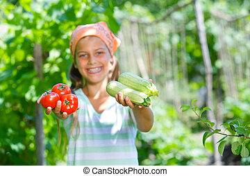 Girl holding a vegetable