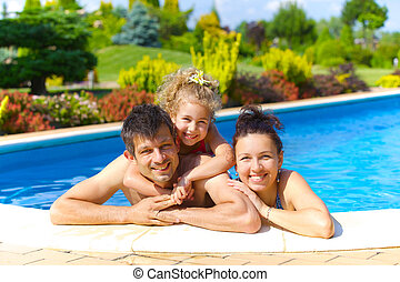Family in the pool - Pretty little girl with her parent in...