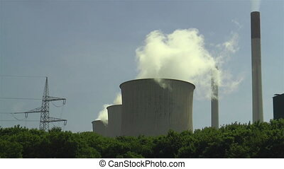 cooling towers and smokestacks  of a power plant closeup