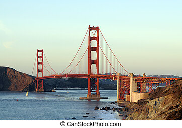 Golden gate bridge from the Presidio, with sail boats in the...