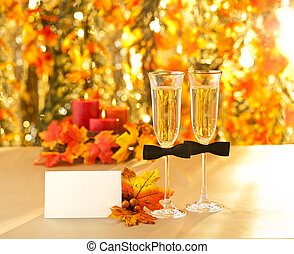 Champagne glasses with conceptual same sex decoration for...