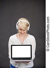 Woman With Headphones And Laptop - Happy young blond woman...