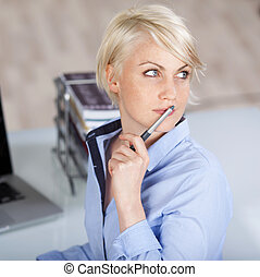 Beautiful Thoughtful Female Executive With Pen - Closeup of...