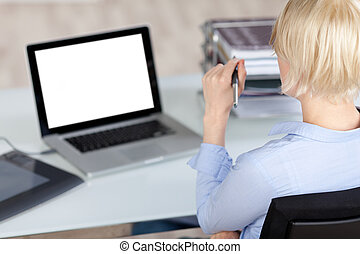 Creative Office Worker Looking At Laptop - Rear view of a...