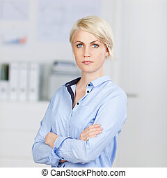 Confident Businesswoman With Arms Crossed - Portrait of a...