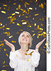 Happy Young Woman In Golden Rain - Happy young blond woman...