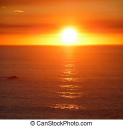 Dramatic blazing sunset over the ocean - A dramatic blazing...