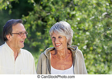 Elderly couple enjoying the greenery