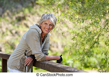 Sweet elderly woman smiling for the camera