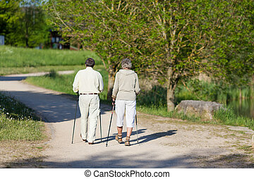 Elderly couple wandering in the park together - Elderly...