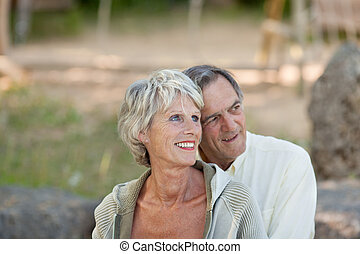 Mature couple - Portrait of mature couple looking over the...