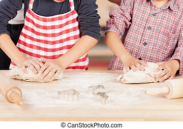 Brothers Kneading Cookie Dough At Kitchen Counter -...