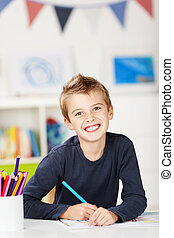 Happy young boy drawing - Happy young boy draw something on...