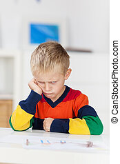 Angry Looking Boy In Kindergarten - Sad little boy with...