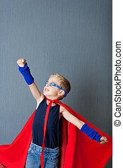 Boy In Super Hero Costume Pretending To Fly - Little boy in...