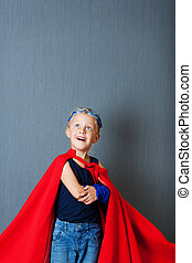 Little Superhero - Little boy playing superhero and wearing...