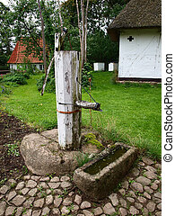Old well water pump in a farm - Old vintage well water pump...