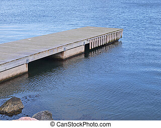 Small wooden jetty dock pier in a marina