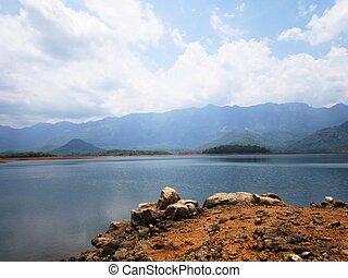 Rocks next to huge lake