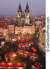 Christmas market in Prague - Sunset on Old Town Square with...