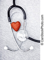 Stethoscope and heart - Medical stethoscope and heart on a...
