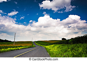 Country backroad through farms in Southern York County,...