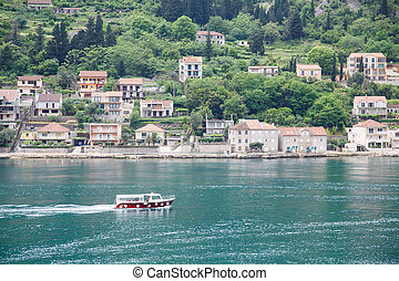 Red and White Ferry Past Coast of Montenegro - Houses and...