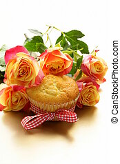 cake muffin with a bouquet of roses