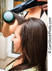 at hairdresser - young woman at hairdresser do hairstyling
