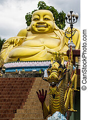 Statuette of Hotei (Buddha) AND dragon in Thailand