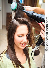 at hairdresser - young woman at hairdresser