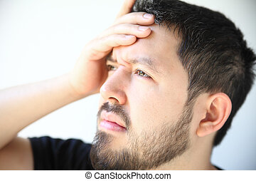 young man with head pain