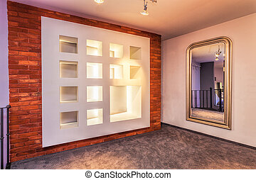 Decorative wall and huge mirror in modern interior