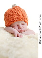 newborn on the blanket with white background