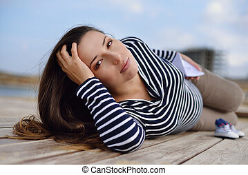 beautiful pregnant woman on the sea coast - beautiful...