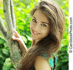 Summer bright portrait of beautiful woman with happy smile....