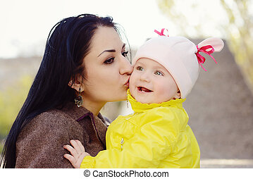 loving mother with baby - loving mother kissing her  baby