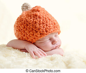 so sweet - sweet newborn wearing orange hat
