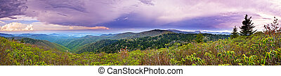 180 degree panorama of mountains and storm