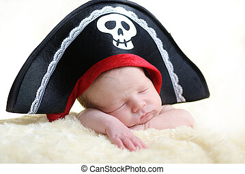 pirate - newborn wearing big pirate hat
