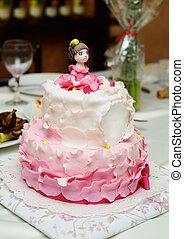 birthday cake decorated with fondant with girl on the top
